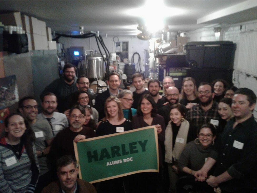 These New York City Harley Alums Roc! From the left, front row: Abby Whitbeck '01, Rob Laney '90, Paul Zinman '80, Barrie Steinberg, Kim Sahler Budd '97, Whitney Brice, Karen Saludo, Rebecca Rothkopf, Jenna Fain Wise '05 (with Harry), Jane Merrill '08, and Bryan Wise. Second row: Matt Budd, Timon Perry '97, Jason Sahler '96, Melody Burgo, Paul Burgo '97, Larry Frye, Ben Kurchin '12, Nathan Duckles '04, John Voelcker '77, Andy Rea '05, Anna Kieburtz '06, Sawyer Jacobs '05, Karin Deutsch '89, and Minnie Cho '85